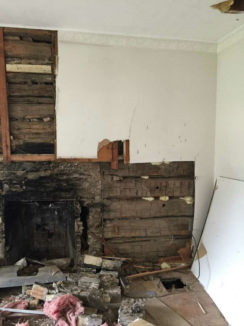 A land developer found a log cabin dating back to the 1860s while tearing out the walls of a home in Flower Mound he acquired as part of a land development plan.