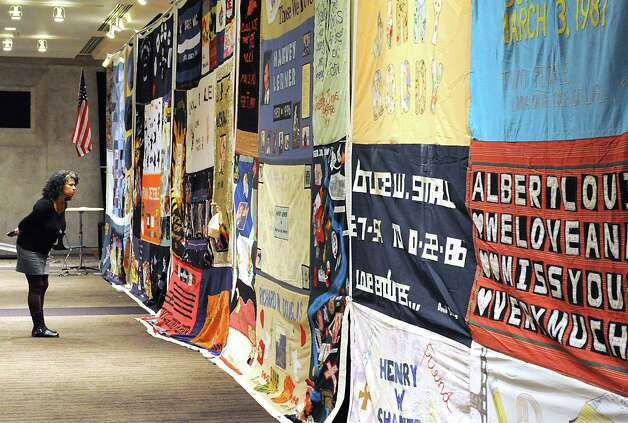 Wendy Milligan of Albany looks at the AIDS Memorial Quilt displayed by The NAMES Project Foundation in the Convention Center on World AIDS Day at the Empire State Plaza on Monday, Dec. 1, 2014, in Albany, N.Y. (Lori Van Buren / Times Union archive) Photo: Lori Van Buren / 00029677A