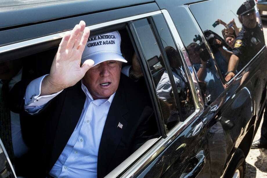 Donald Trump, the real estate mogul and reality television personality, waves from his motorcade after leaving a news conference in Laredo, Texas, July 23, 2015. Trump's trip to this border town to push his anti-immigration cause drew the type of media circus the Republican presidential hopeful craves. (Tamir Kalifa/The New York Times) Photo: TAMIR KALIFA, STR / New York Times / NYTNS