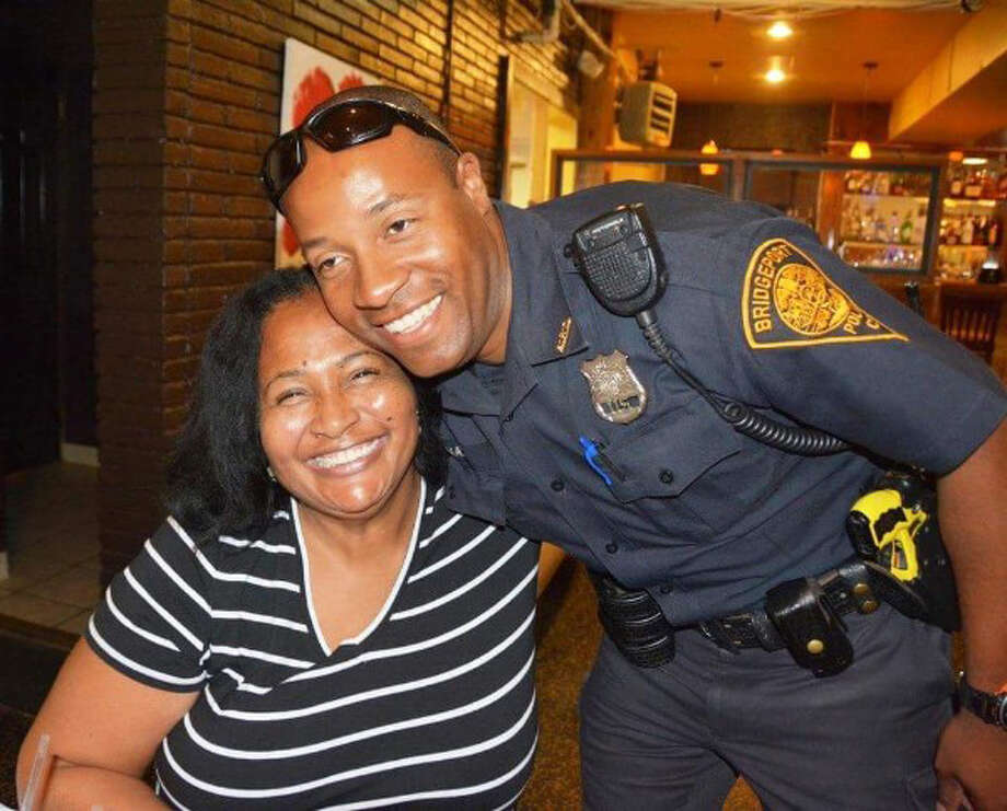 Carolyn Vermont with her friend, Officer Sheldon Mayne. who was in a near fatal motorcycle accident on Aug. 14 and is in critical condition. He is in a coma and fighting for his life. Mayne is the provider for his mother, sister and nephew. Photo: Contributed Photo / Connecticut Post Contributed
