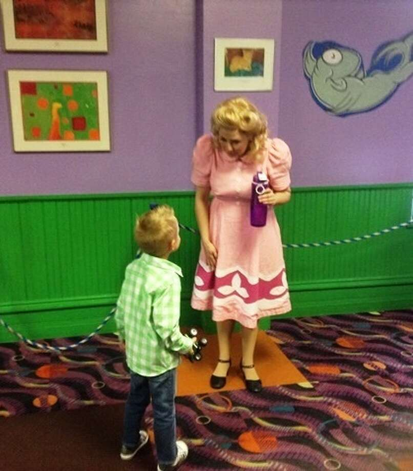 """Actress Becky King visits with a young patron following a sensory-friendly performance of """"Elephant & Piggie."""" Photo: Courtesy Photo"""
