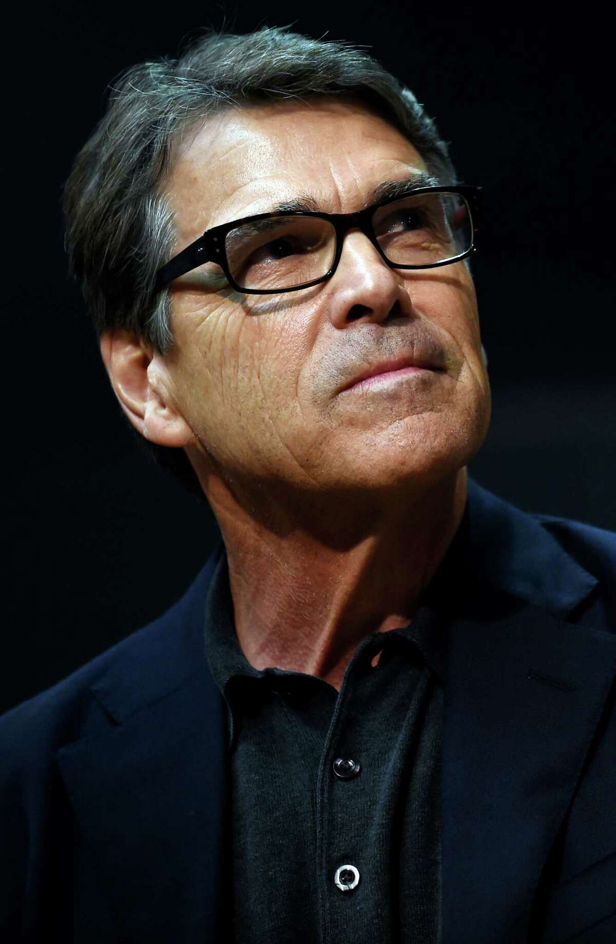 Republican presidential candidate, former Texas Gov. Rick Perry listens during a campaign stop at Anderson Christian School on Thursday, Aug. 13, 2015, in Anderson, S.C. (AP Photo/Rainier Ehrhardt)