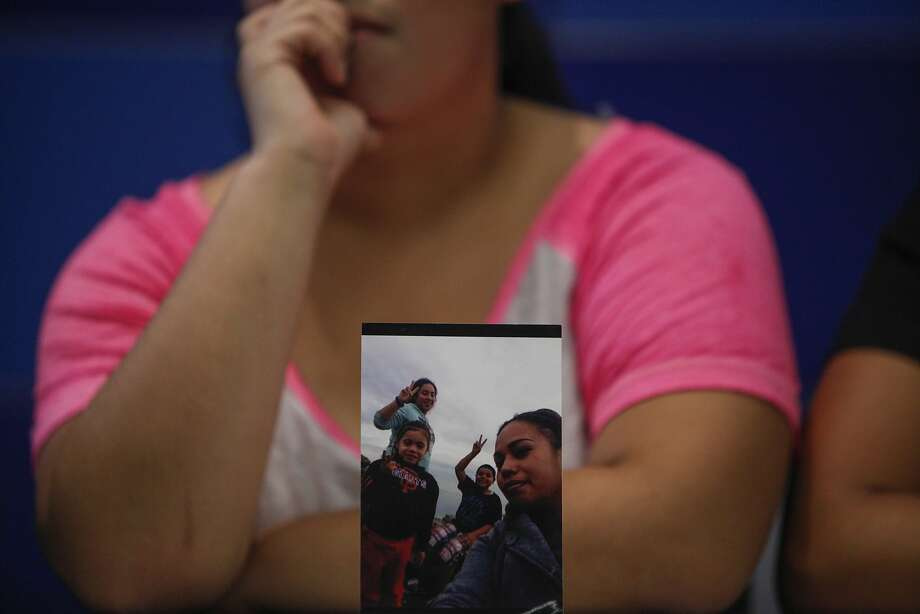 A photo of homicide victim Lourdes Soza and her children is seen in front of her daughter, Brianna. Photo: Loren Elliott, The Chronicle