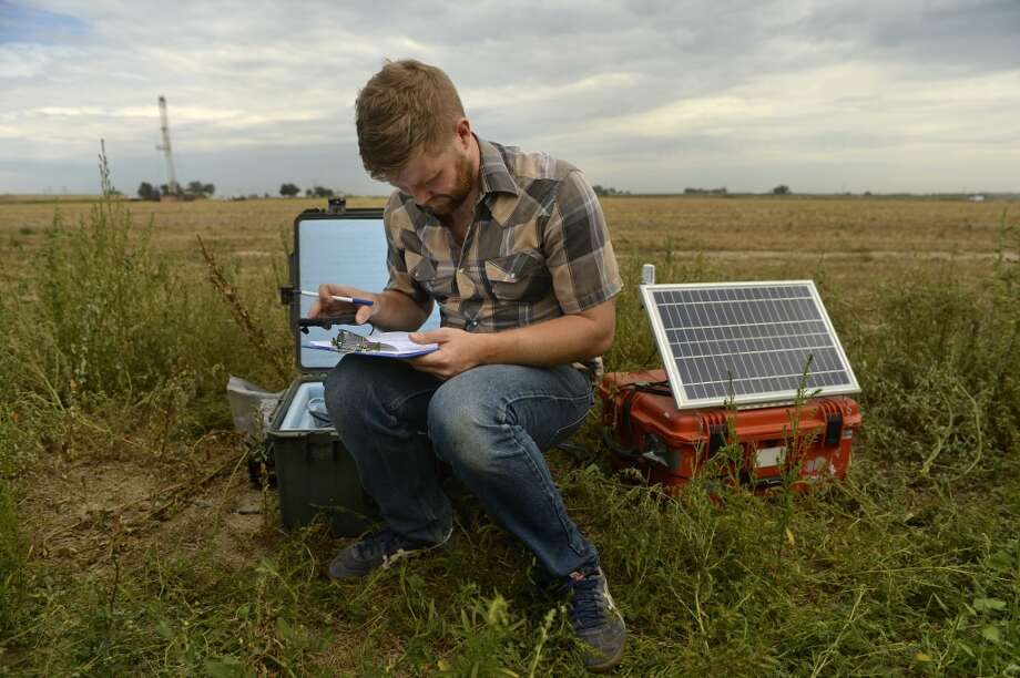 A researcher checks seismometers where he is monitoring seismic activity. Some believe the recent earthquakes in Oklahoma and in North Texas may have been caused by wastewater injection wells used in fracturing. Photo: RJ Sangosti, Denver Post Via Getty Images