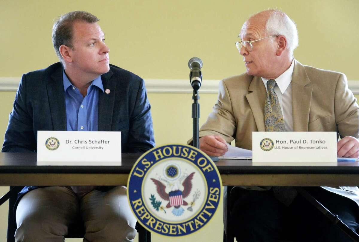 Dr. Chris Schaffer, left, joins Congressman Paul Tonko at a roundtable on the federal BRAIN Initiative, which aims to reveal information on neurological and psychiatric disorders at the The Crossings Tuesday August 18, 2015 in Colonie, NY. (John Carl D'Annibale / Times Union)