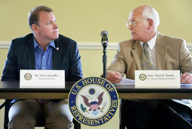 Dr. Chris Schaffer, left, joins Congressman Paul Tonko at a roundtable on the federal BRAIN Initiative, which aims to reveal information on neurological and psychiatric disorders at the The Crossings Tuesday August 18, 2015 in Colonie, NY.  (John Carl D'Annibale / Times Union) Photo: John Carl D'Annibale / 00033024A