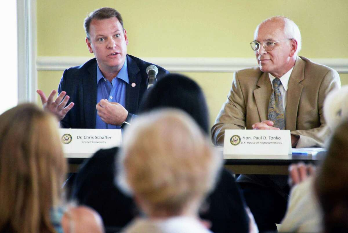 Dr. Chris Schaffer, left, of Cornell University joins Congressman Paul Tonko at a roundtable on the federal BRAIN Initiative, which aims to reveal information on neurological and psychiatric disorders at the The Crossings Tuesday August 18, 2015 in Colonie, NY. (John Carl D'Annibale / Times Union)