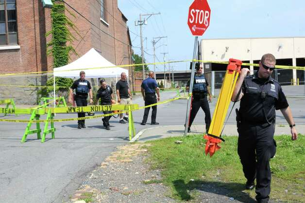 Troy police investigate the scene of an early morning shooting on Old Sixth Ave. Tuesday, Aug. 18, 2015, in Troy, N.Y. (Lori Van Buren/Times Union) Photo: WW / 00033051A