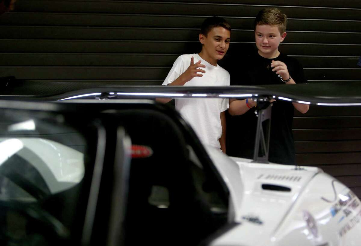 Chris Lerma, 15, and Brandon Bolitho, 14, along with 29 other incoming freshman, participated in the Build and Soar summer program, building a car unveiled to family and Lamar Consolidated officials on Tuesday.