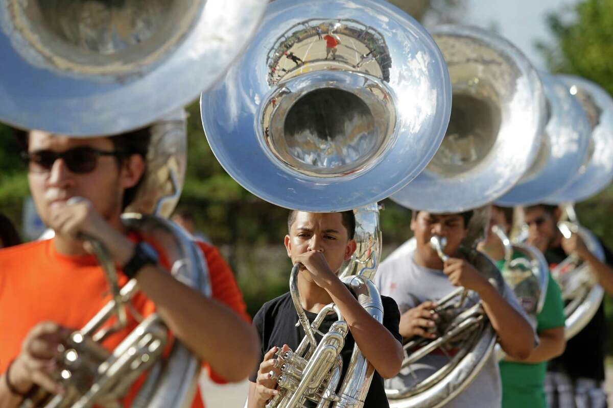 Members of the Waltrip High School marching band practice Tuesday, Aug. 18, 2015, in Houston. ( Melissa Phillip / Houston Chronicle )