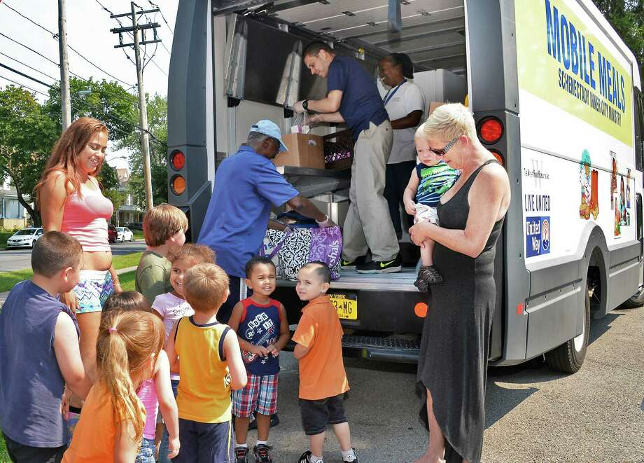Paula Stewart brings the children from her daycare to get lunch from one of two new mobile meal trucks at Ellis Hospital on McClellan Street Tuesday August 18, 2015 in Schenectady, NY. The Mobile Meals vehicles were made possible by grants totaling $100,000 from the United Way of the Greater Capital Region, the Wright Family Foundation, the Carlilian Foundation, the Upper NY Conference of the United Methodist Church and SICM.  (John Carl D'Annibale / Times Union) Photo: John Carl D'Annibale / 00033037A