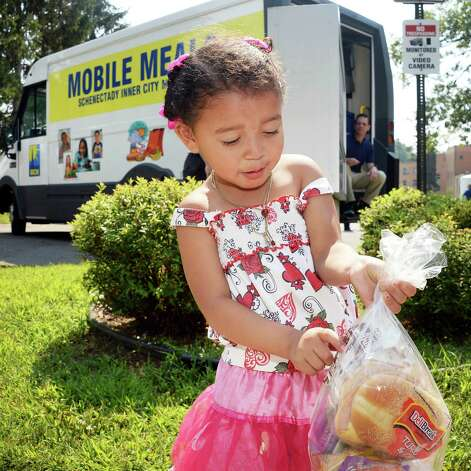 Three-year-old Leonela Osorio of Schenectady points out her favorite chocolate milk in a free lunch she received from from one of two new mobile meal trucks at Ellis Hospital on McClellan Street Tuesday August 18, 2015 in Schenectady, NY. The Mobile Meals vehicles were made possible by grants totaling $100,000 from the United Way of the Greater Capital Region, the Wright Family Foundation, the Carlilian Foundation, the Upper NY Conference of the United Methodist Church and SICM.  (John Carl D'Annibale / Times Union) Photo: John Carl D'Annibale / 00033037A