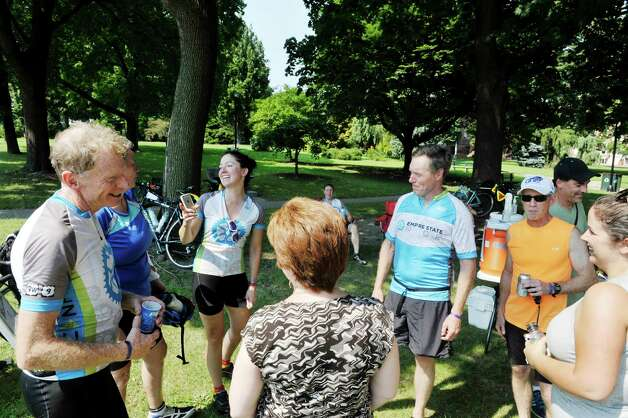Riders taking part in The Empire State Ride talk  with Albany Mayor Kathy Sheehan, foreground back to camera,  on Tuesday, Aug. 18, 2015, in Albany, N.Y.  The riders are raising money for the Roswell Park Cancer Institute on their seven-day, 518-mile ride that will end at Niagara Falls on Aug. 22nd.  The riders began their ride on Aug. 16th in New York City.  This is the first year of what organizers say will be a yearly event.  (Paul Buckowski / Times Union) Photo: PAUL BUCKOWSKI / 00032546A
