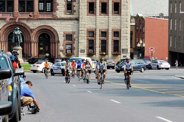 Riders taking part in The Empire State Ride ride up Washington Ave. after stopping for a break on Tuesday, Aug. 18, 2015, in Albany, N.Y.  The riders are raising money for the Roswell Park Cancer Institute on their seven-day, 518-mile ride that will end at Niagara Falls on Aug. 22nd.  The riders began their ride on Aug. 16th in New York City.  This is the first year of what organizers say will be a yearly event.  (Paul Buckowski / Times Union) Photo: PAUL BUCKOWSKI / 00032546A