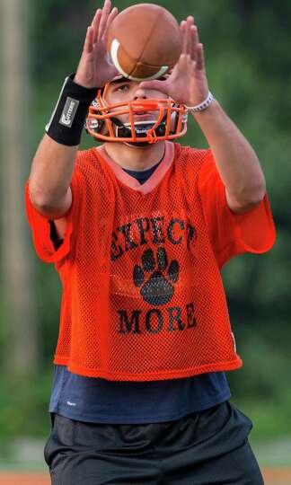 Ridgefield High School varsity football quarterback A.J. Fabbri taking ...