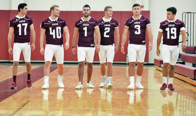 Union football captains, from left, #17, Joe Vito, #40, Nick Littas, #1, Kyle Reynolds, #2, A.J. Baker, #3, Jake LaRovera, and #19, Tyler Valenti head off for team photos during Union Football Media Day at the college Tuesday August 18, 2015 in Schenectady, NY.   (John Carl D'Annibale / Times Union) Photo: John Carl D'Annibale / 00033048A