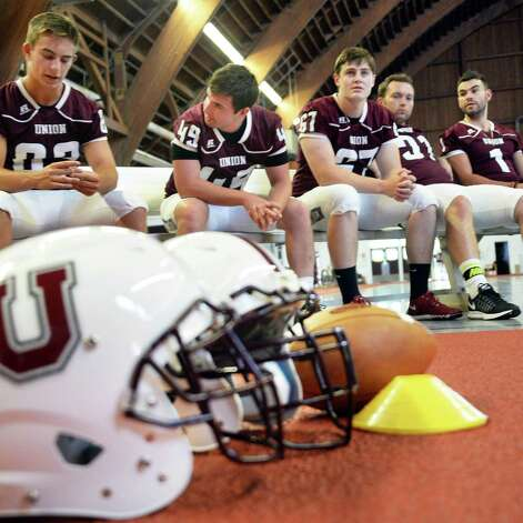 Players wait to have their pictures taken during Union Football Media Day at the college Tuesday August 18, 2015 in Schenectady, NY.   (John Carl D'Annibale / Times Union) Photo: John Carl D'Annibale / 00033048A