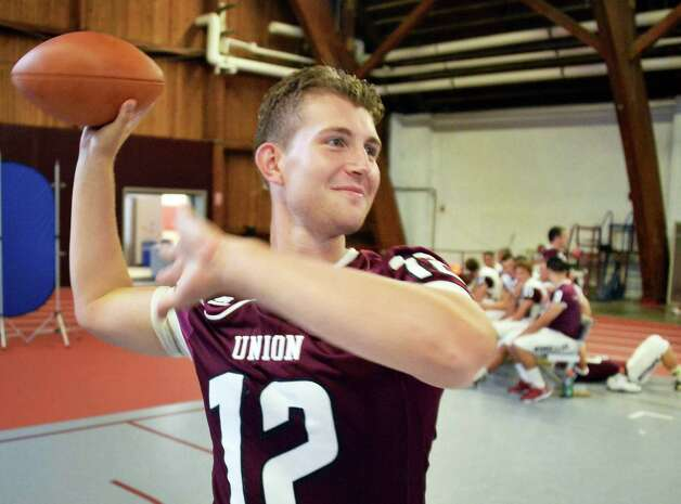 Quarteback Dante Cioffi tosses a football during Union Football Media Day at the college Tuesday August 18, 2015 in Schenectady, NY.   (John Carl D'Annibale / Times Union) Photo: John Carl D'Annibale / 00033048A
