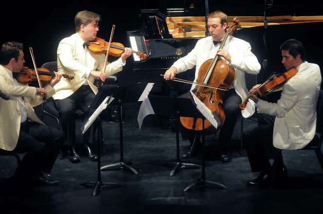 The Escher String Quartet: Adam Barnett-Hart (violin), Aaron Boyd (violin), Brook Speltz (cello), Pierre Lapointe (viola) perform during the Chamber Music Society of Lincoln Center event at the SPAC Little Theater on Tuesday Aug. 18, 2015 in Saratoga Springs, N.Y.  (Michael P. Farrell/Times Union) Photo: Michael P. Farrell / 00033053A