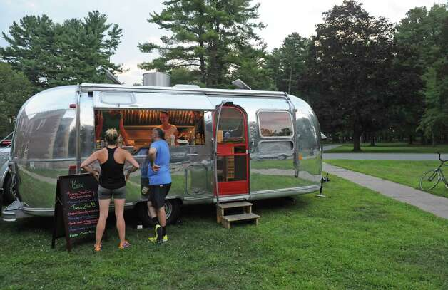 An Airstream trailer converted into a food truck served up eclectic mexican food offerings outside  the Chamber Music Society of Lincoln Center event at the SPAC Little Theater on Tuesday Aug. 18, 2015 in Saratoga Springs, N.Y.  (Michael P. Farrell/Times Union) Photo: Michael P. Farrell / 00033053A