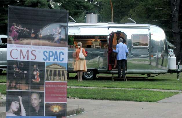 An Airstream trailer converted into a food truck by Airstream Catering Company served up eclectic mexican food offerings outside  the Chamber Music Society of Lincoln Center event at the SPAC Little Theater on Tuesday Aug. 18, 2015 in Saratoga Springs, N.Y.  (Michael P. Farrell/Times Union) Photo: Michael P. Farrell / 00033053A