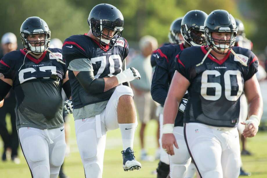 Houston Texans guard Cody White (67), tackle Jeff Adams (70) and center Ben Jones (60) stretch during Texans training camp at the Methodist Training Center Tuesday, Aug. 11, 2015, in Houston. Photo: Brett Coomer /Houston Chronicle / © 2015 Houston Chronicle