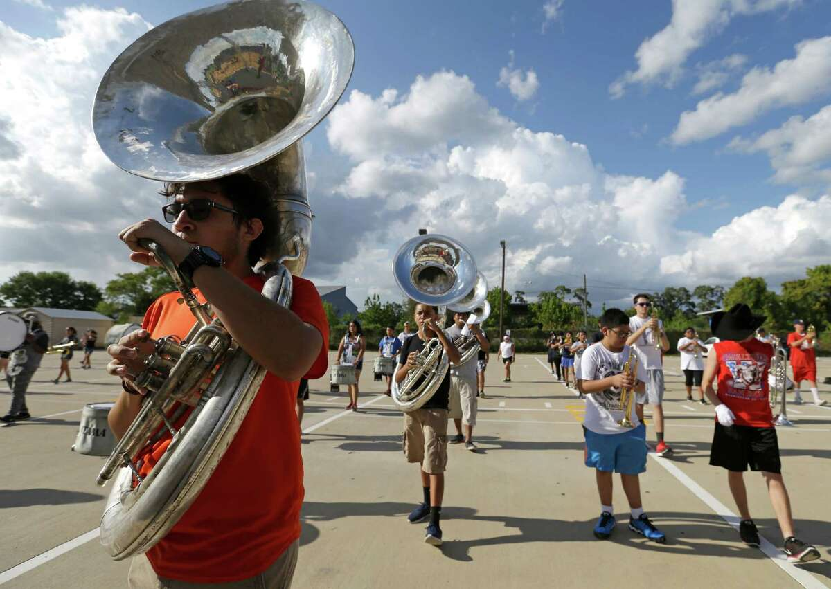 Members of the Waltrip High School marching band practice Tuesday, Aug. 18, 2015, in Houston.