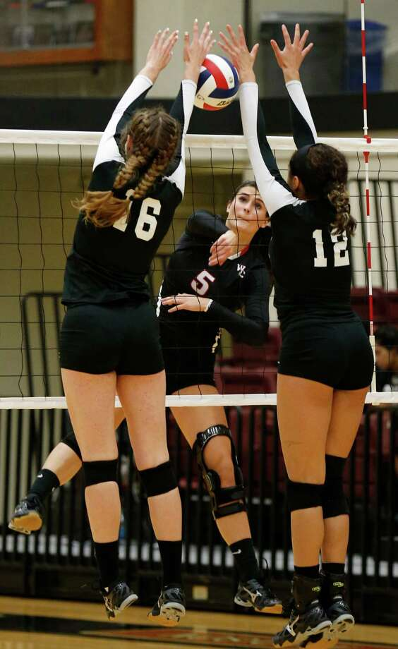 Churchill's Abby Buckingham (05) attempts to hit through Clark's Lindsay McDonough (16) and Maylin Garrett (12) in a non-district volleyball game at Littleton Gym on Tuesday, Aug. 18, 2015. (Kin Man Hui/San Antonio Express-News) Photo: Kin Man Hui, Staff / San Antonio Express-News / ©2015 San Antonio Express-News