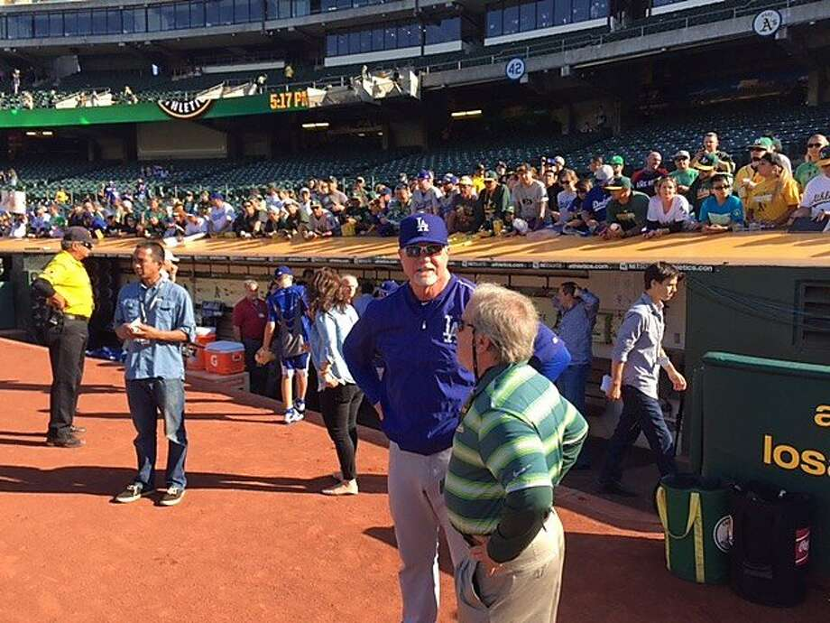 Dodgers batting coach Mark McGwire getting ready for his team to take batting practice at the Coliseum on Tuesday. Photo: Steve Kroner, The Chronicle
