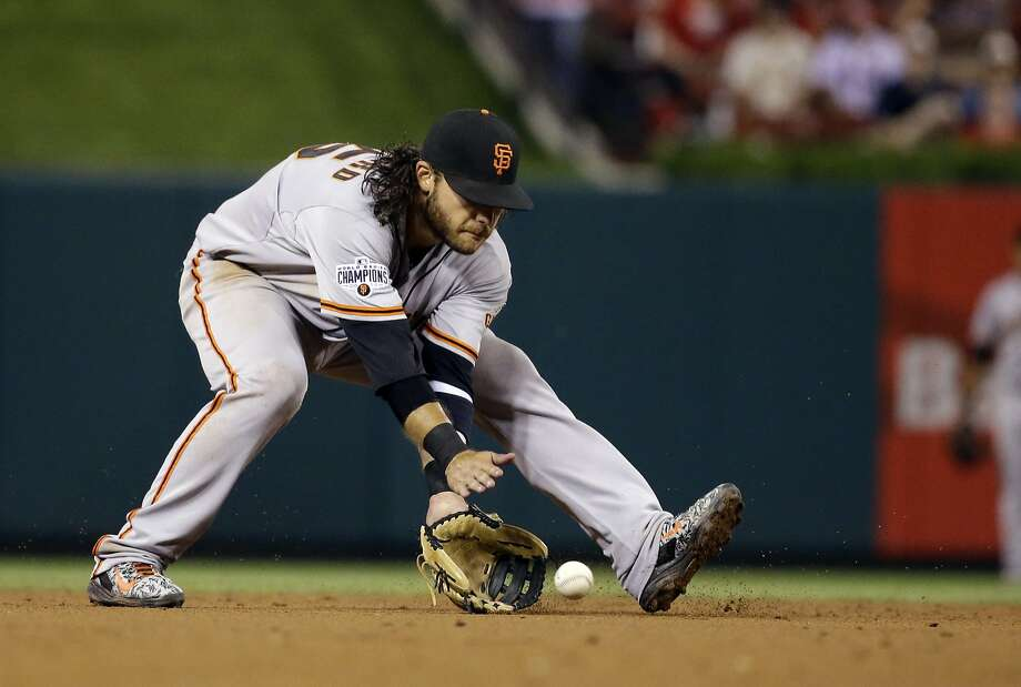 San Francisco Giants shortstop Brandon Crawford handles a grounder hit by St. Louis Cardinals' Stephen Piscotty during sixth inning of a baseball game Tuesday, Aug. 18, 2015, in St. Louis. (AP Photo/Jeff Roberson) Photo: Jeff Roberson, Associated Press