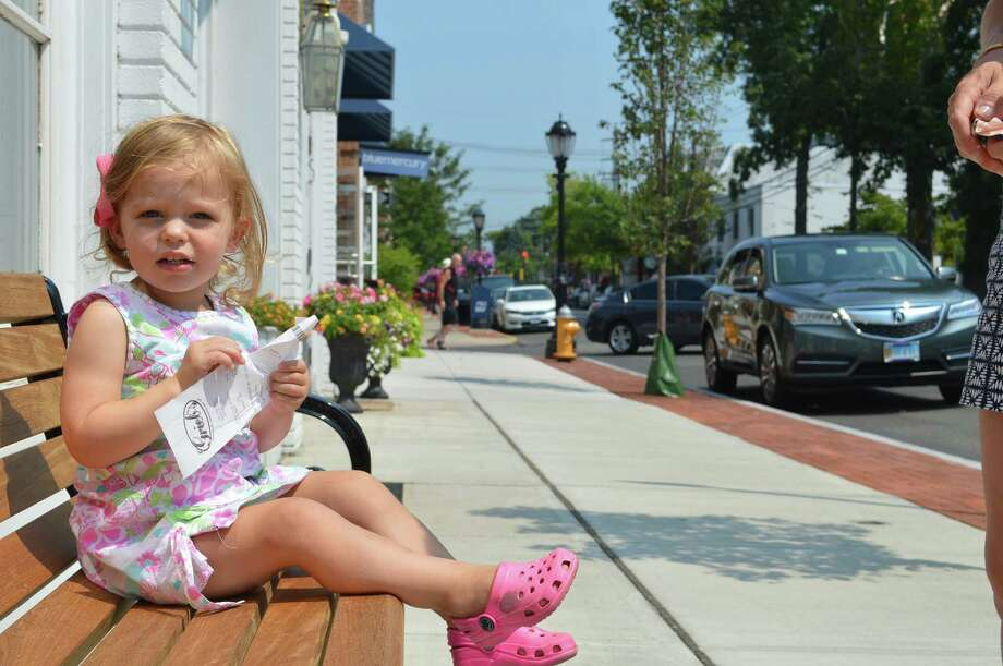 Hayden Farnum, of Darien, didn't let the heat bother her Tuesday as she enjoyed a quiet moment on Post Road. Photo: Jarret Liotta /For Hearst Connecticut Media
