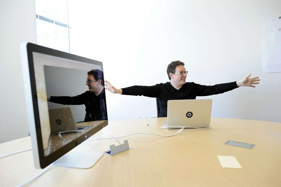 Founder Ben Nelson is reflected in a computer screen as he talks about the elite private online college the Minerva School at KGI, during an interview at their offices in San Francisco, CA Tuesday, August 18, 2015. Photo: Michael Short, Special To The Chronicle