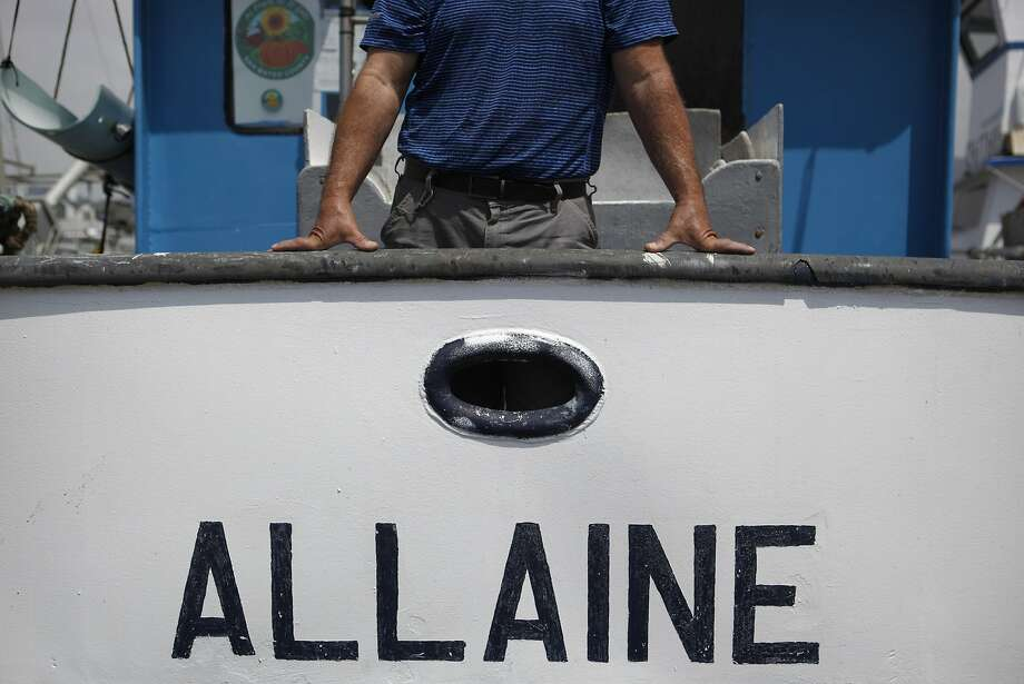 Jim Anderson poses with his commercial fishing boat at Pillar Point Harbor in Half Moon Bay, California, on Tuesday, Aug. 18, 2015. Photo: Brandon Chew, The Chronicle