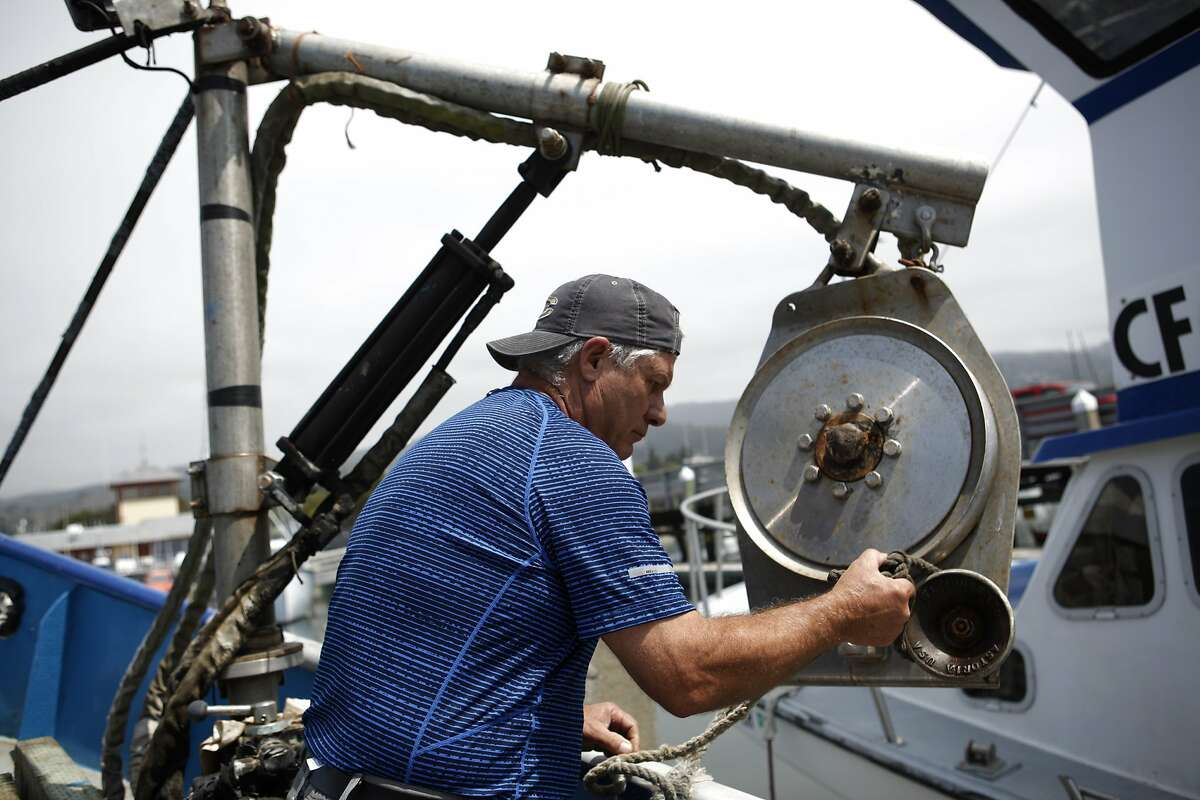 Jim Anderson works on his commercial fishing boat at Pillar Point Harbor in Half Moon Bay, California, on Tuesday, Aug. 18, 2015.