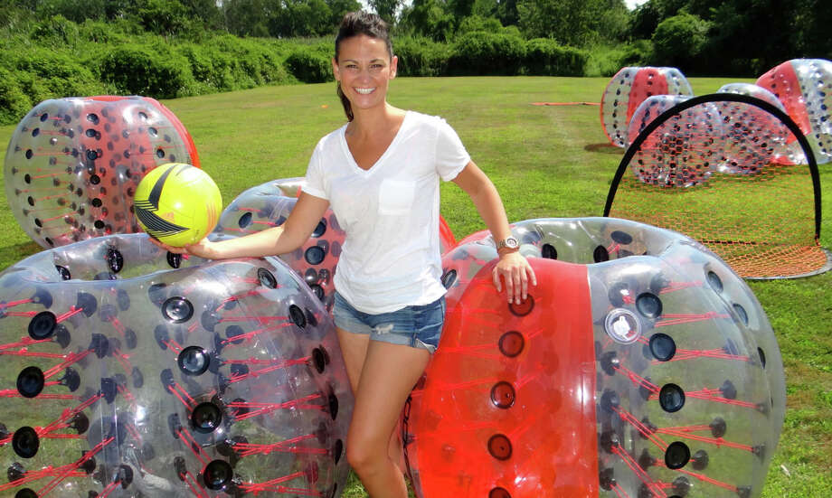 Kristyn Boynton, of Team New England, coordinated KnockerBall fun at the Smorgasbord on Pine Creek event Saturday at the Scandinavian Club. Photo: Mike Lauterborn / For Hearst Connecticut Media / Fairfield Citizen