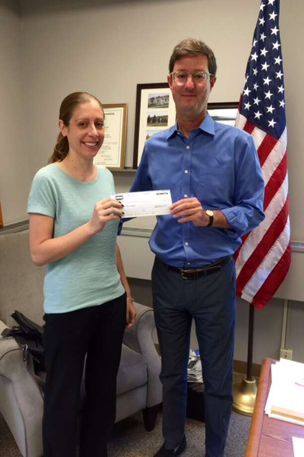 Sherman First Selectman Clay Cope receives an equity distribution of $4.9K from the town's CIRMA representative. Photo: / Contributed Photo