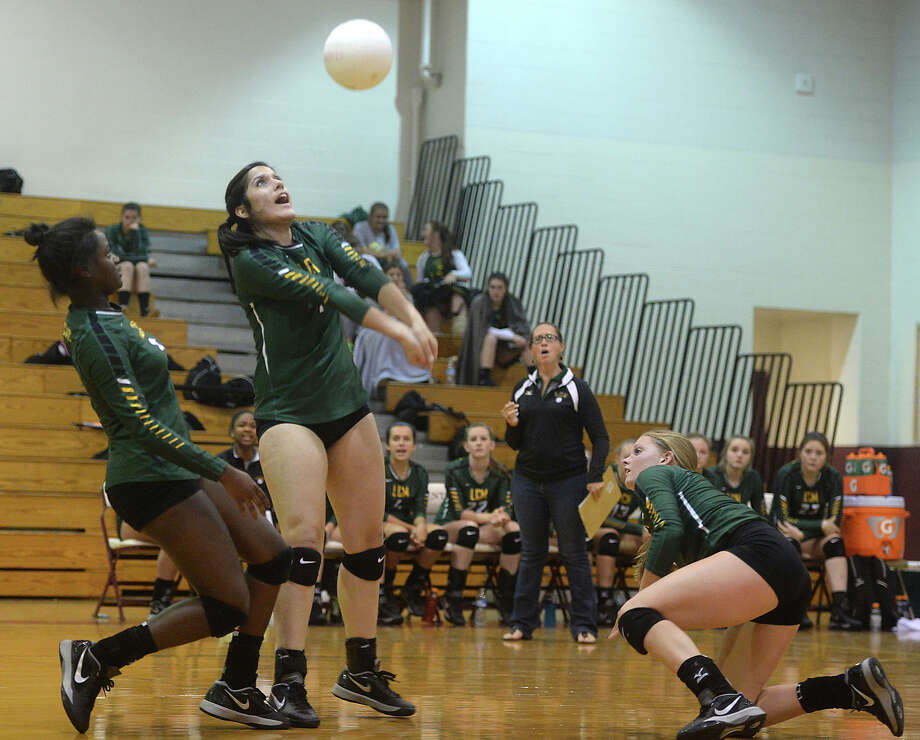 Little Cypress - Mauriceville's Heidi Bailleaux keeps the ball alive against Central during their volleyball match-up Tuesday at Central High School.   Photo taken Tuesday, August 18, 2015  Kim Brent/The Enterprise Photo: Kim Brent / Beaumont Enterprise