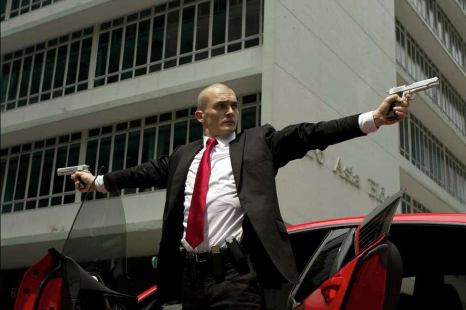 "Rupert Friend takes up the guns in ""Hitman: Agent 47, "" a reboot of 2007's ""Hitman."" (20th Century Fox) Photo: Reiner Bajo/20th Century Fox, HO / TNS"