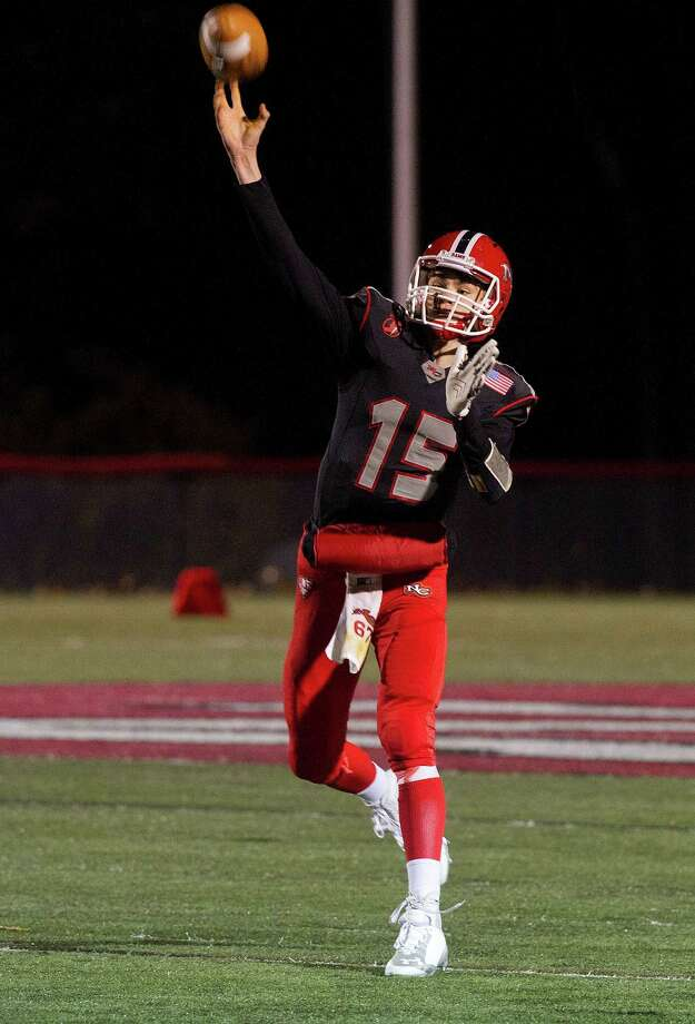 New Canaan's Michael Collins throws a pass during Friday's football game against Wilton at New Canaan High School on November 7, 2014. Photo: Lindsay Perry / Lindsay Perry / Stamford Advocate
