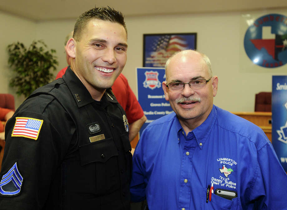 Sgt. Cody Guedry and Chief Danny Sullins pose for a photo Thursday afternoon. The Crime Stoppers Hardin County mixer was held at the Lumberton City Hall on Thursday afternoon. Photo taken Thursday 8/6/15 Jake Daniels/The Enterprise Photo: Jake Daniels / ©2015 The Beaumont Enterprise/Jake Daniels