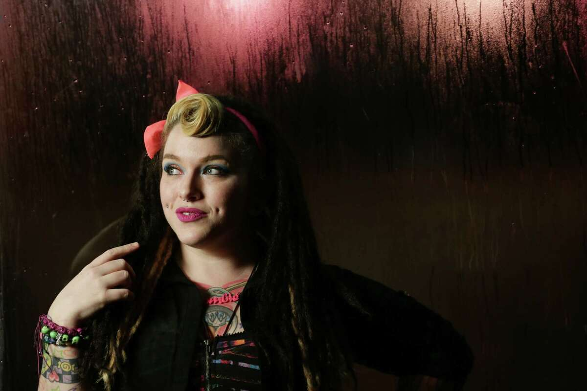 Nina Lombardo poses for a portrait during a karaoke night at JR's Bar and Grill Sunday, Aug. 16, 2015, in Houston. Lombardo, a singer and entertainer, is also the host of this year's Pride Superstar singing competition. ( Jon Shapley / Houston Chronicle )