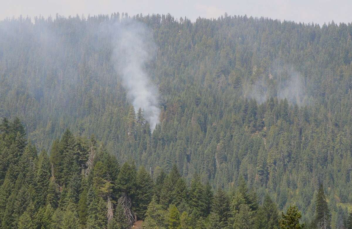 After lightning strike the night before, smoke rises up from the early stages of a forest fire in the Klamath Mountains on edge of Marble Mountain Wilderness. A fire-fighting helicopter doused it with water, and a Hot Shot crew kept it from growing into an inferno.
