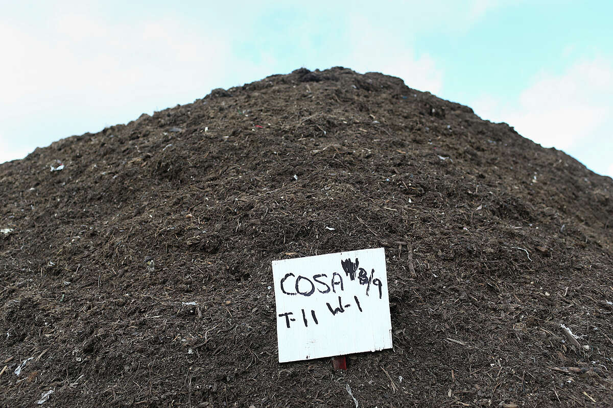 """A pile of organic material picked up by the City of San Antonio Solid Waste Department is dated as it turns into compost at the New Earth Soils and Compost facility at 7800 East IH-10, Tuesday, August 18, 2015. The city is offering its residents lower rates for garbage service by letting them recycle more of their waste for a lower bill under a program called, """"Pay as You Throw"""". Residents have the option of cutting their solid waste collection fee by choosing a smaller garbage bin and recycling more items."""