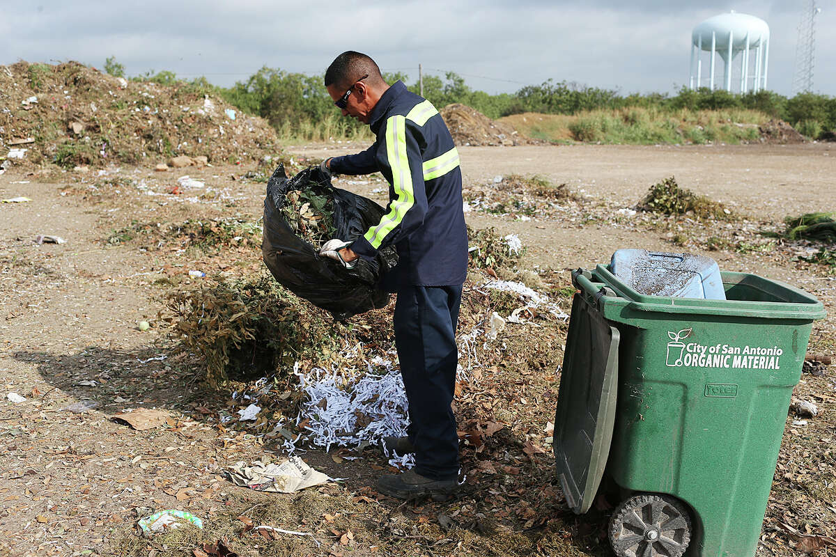 """Organic Monitor Larry Rosalez sorts through organic material picked up by the City of San Antonio Solid Waste Department at the New Earth Soils and Compost facility at 7800 East IH-10, Tuesday, August 18, 2015. Rosalez takes out inorganics, such as plastics and bottles, from the material that is turned into compost. The city is offering its residents lower rates for garbage service by letting them recycle more of their waste for a lower bill under a program called, """"Pay as You Throw"""". Residents have the option of cutting their solid waste collection fee by choosing a smaller garbage bin and recycling more items."""