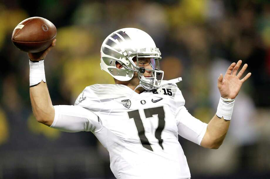 Quarterback Jeff Lockieof the Oregon Ducks warms up prior to the College Football Playoff National Championship Game against the Ohio State Buckeyes at AT&T Stadium on January 12, 2015 in Arlington, Texas. Photo: Christian Petersen /Getty Images / 2015 Getty Images