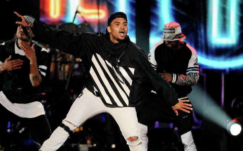 In this Nov. 7 file photo, singer Chris Brown performs during the 2014 Soul Train Awards at Orleans Arena in Las Vegas. Brown is set to perform Sunday, Aug. 23, at the Webster Bank Arena in Bridgeport. Photo: Chris Pizzello / Associated Press / Invision