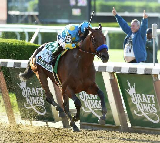 American Pharoah ridden by Victor Espinoza made his way to the record books by winning the 147th running of the Belmont Stakes and thoroughbred racing's Triple Crown June 6, 2015 at Belmont Park in Elmont, N.Y.   (Skip Dickstein/Times Union) Photo: SKIP DICKSTEIN