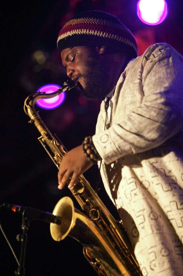 Saxophonist Kamasi Washington performs at The Chop Shop on Aug. 6 in Charlotte, N.C. He will be at the Fairfield Theatre Company's StageOne theater with his band on Friday, Aug. 21. Photo: Jeff Hahne / Getty Images / 2015 Jeff Hahne