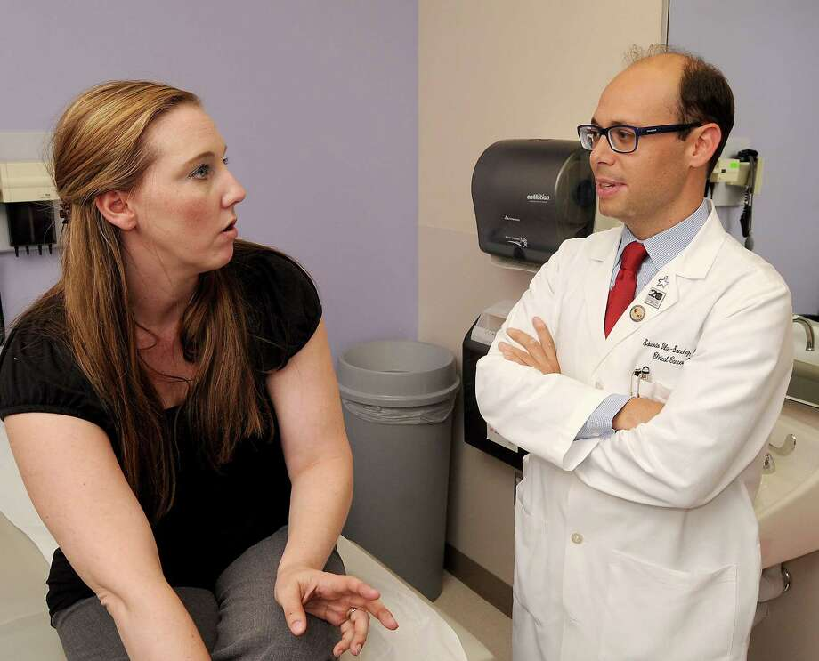Teresa Hall of Spring, talking to MD Anderson Cancer Center's Dr. Eduardo Vilar-Sanchez, was diagnosed with colorectal cancer at 32, part of the growing trend of such cancers in younger population. In response to the trend, the American Cancer Society Wednesday called for people to start getting screened at 45, down from 50 in the decades-old recommendations. Photo: Dave Rossman, Freelance / Freelalnce