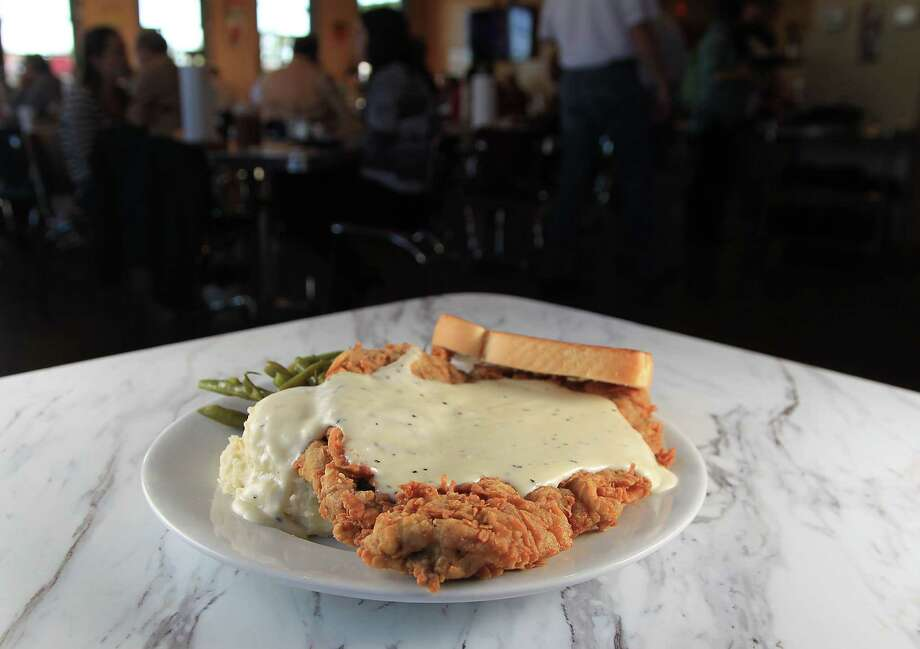 Perhaps no other dish represents Americans' desire for huge restaurant food portions than chicken fried steak, which often is large enough to fill a plate. Photo: James Nielsen, Staff / © 2015  Houston Chronicle